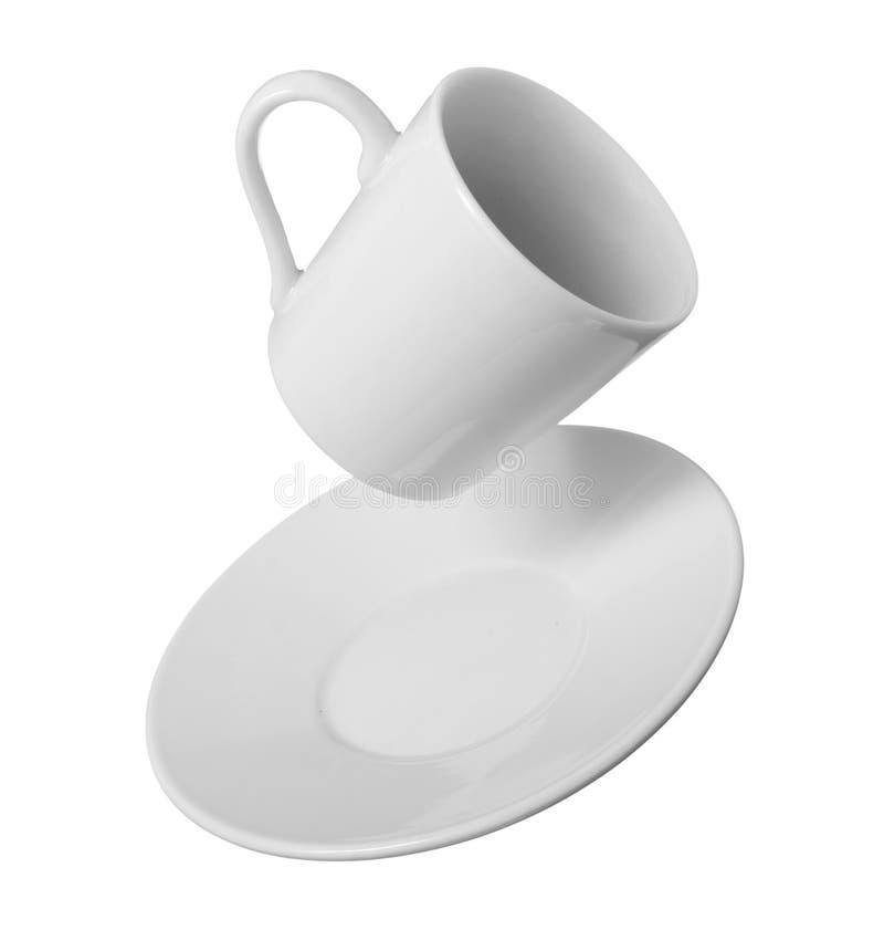 Queda do copo de café branco imagem de stock