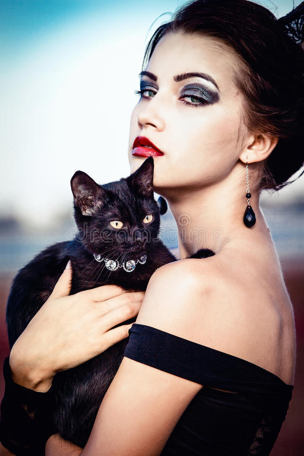 Queen and cat stock images