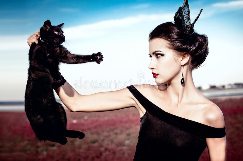 Queen and cat royalty free stock photo
