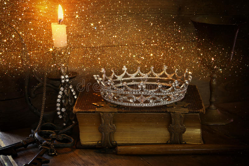 Queen crown on old book. fantasy middle age concept royalty free stock photo