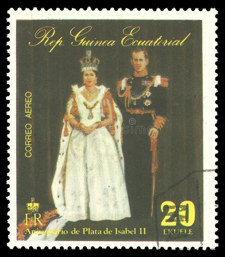 Queen Elizabeth Coronation Anniversary. Guinea Equatorial - stamp 1977: Color edition on 25th Coronation Anniversary, shows Queen Elizabeth II with Prince stock photography