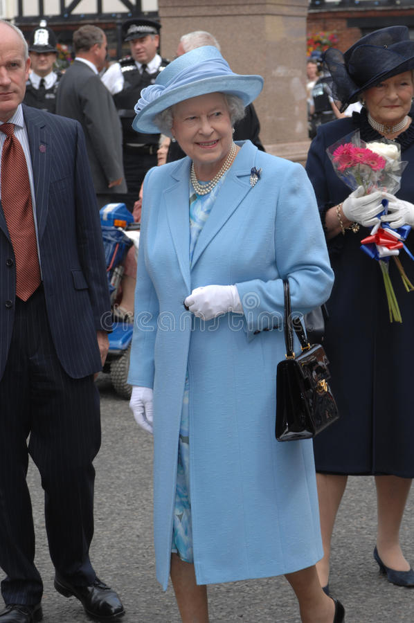 Queen Elizabeth II. ROMSEY. HAMPSHIRE, 2007. Queen Elizabeth II photographed during a Royal vist. Powder blue coat and hat, royal smile