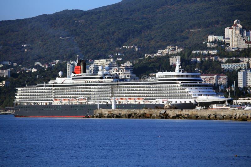 Queen Elizabeth ocean liner in Yalta, Ukraine. Yalta, Ukraine - October 7, 2012: First visit of the Queen Elizabeth ocean liner in the port of Yalta. Queen stock photo
