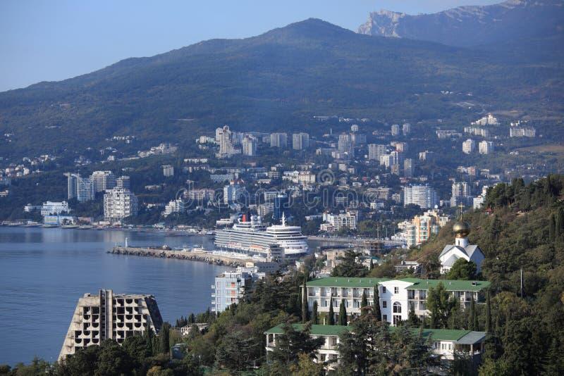 Queen Elizabeth ocean liner in Yalta, Ukraine. Yalta, Ukraine - October 7, 2012: First visit of the Queen Elizabeth ocean liner in the port of Yalta. Queen stock image