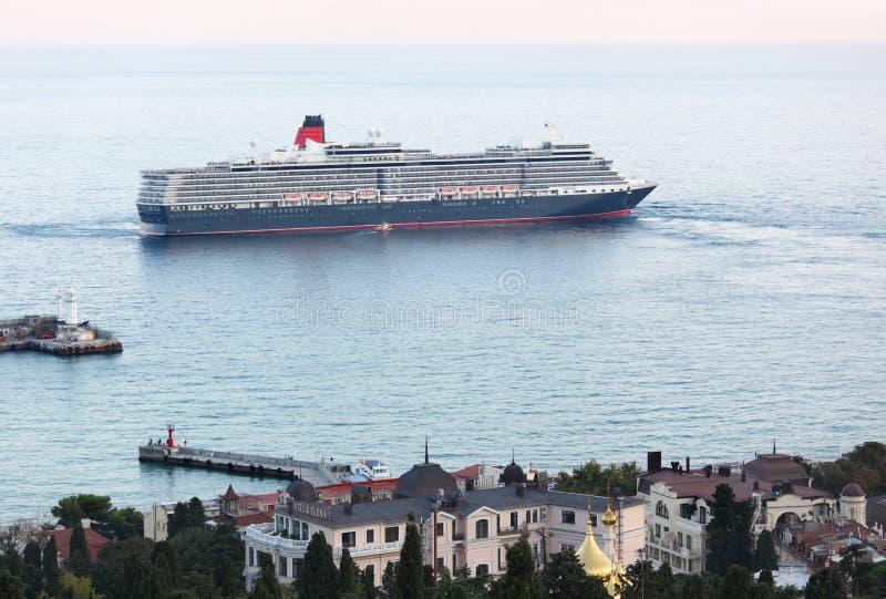 Queen Elizabeth ocean liner in Yalta, Ukraine. Yalta, Ukraine - October 7, 2012: First visit of the Queen Elizabeth ocean liner in the port of Yalta. Queen royalty free stock image