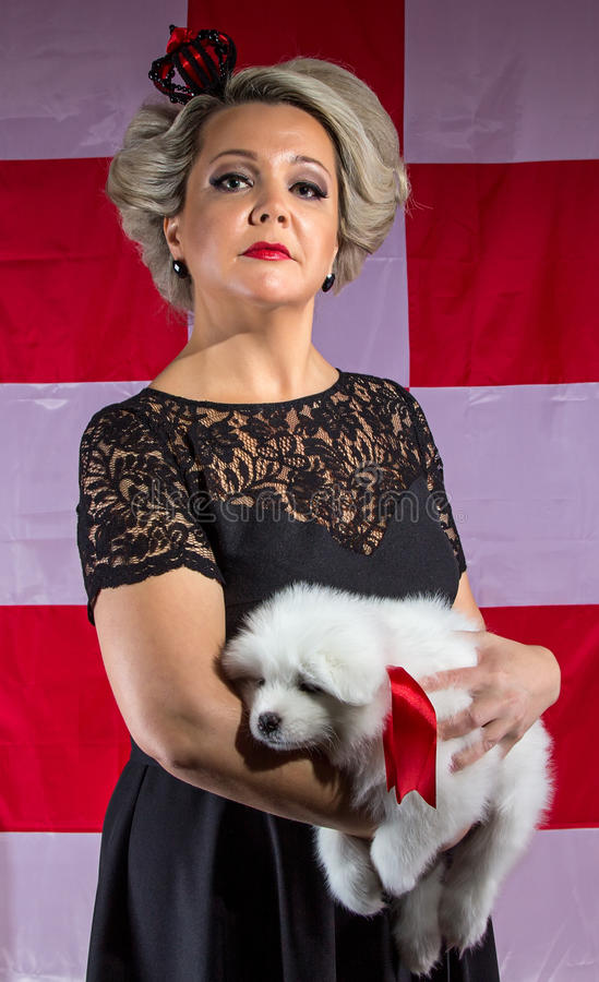 Queen of hearts with white puppy stock photography
