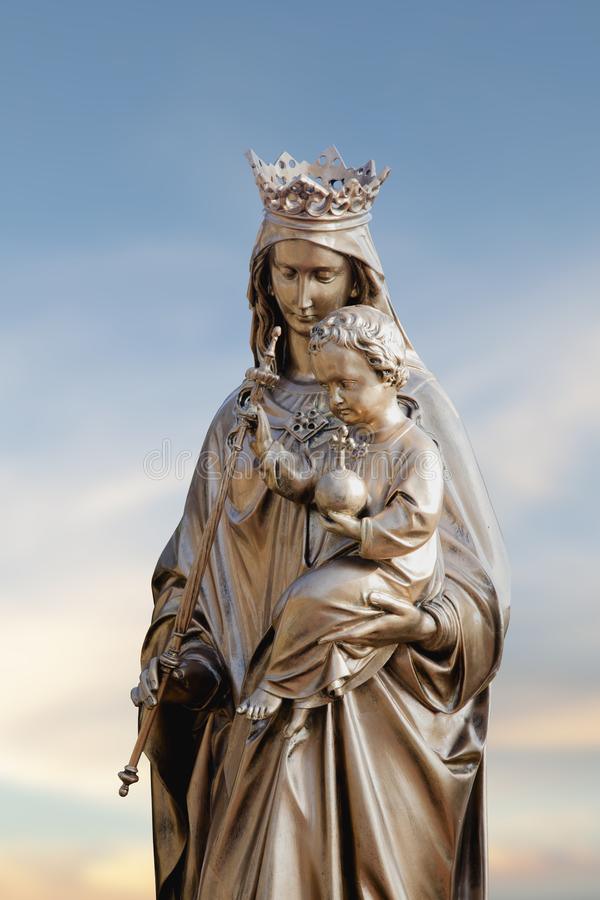 Queen of Heaven. Ancient statue of the Virgin Mary with Jesus Christ stock image
