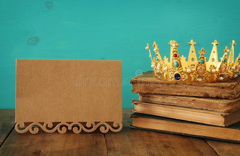 queen/king crown on old book. vintage filtered. fantasy medieval period stock photos