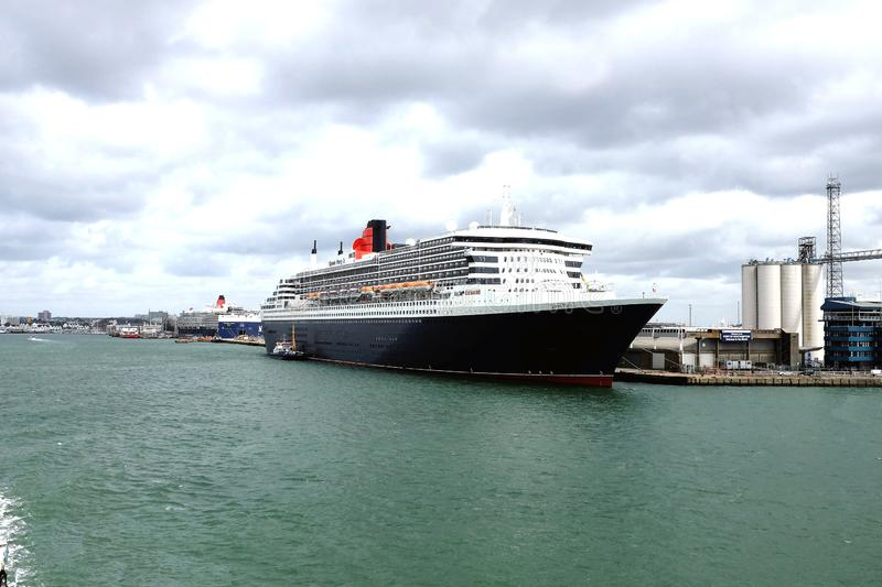 Queen Mary 2 cruise ship, Southampton, UK. Southampton, England, UK. August 11, 2019. The Queen Mary 2 preparing to sail from the docks to New York at royalty free stock image
