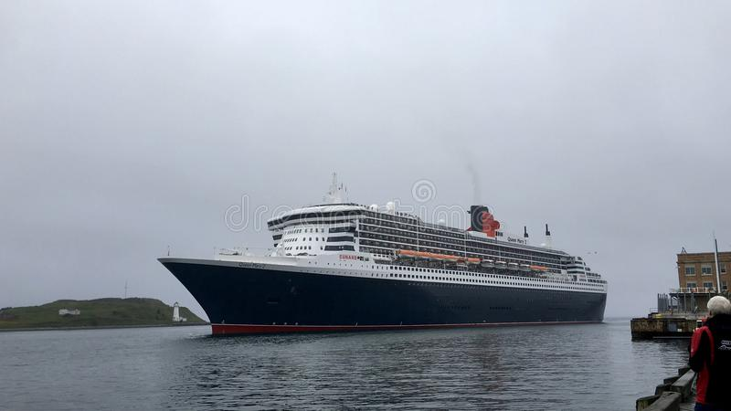 Queen Mary 2 departing berth 22. Queen Mary 2 departs royalty free stock image