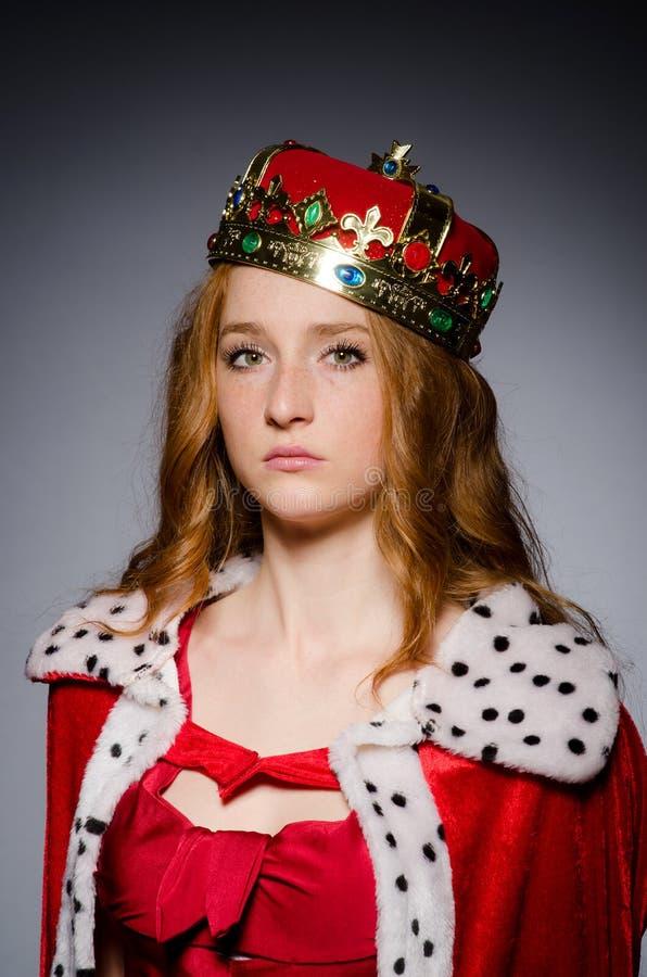 Queen in red dress. In studio stock photo