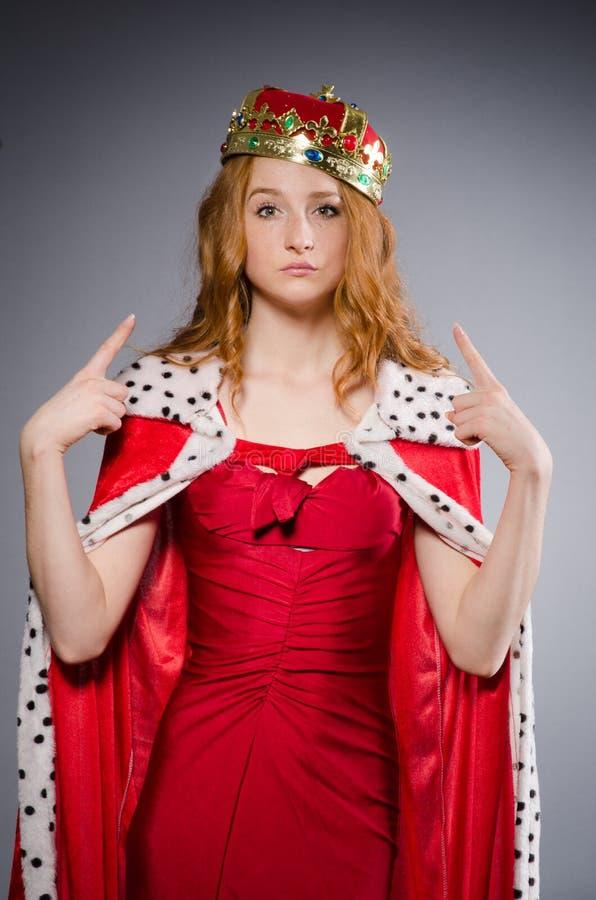 Queen in red dress. In studio stock photos