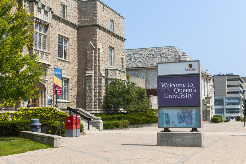 Queen's University campus in Kingston Canada. KINGSTON, CANADA - AUGUST 2, 2014: Welcome sign on Queen's university campus next to Students Memorial Union royalty free stock images