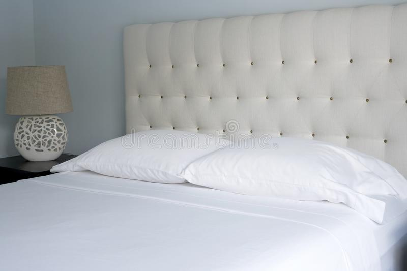 Queen-Sized Crisp White Bed Linens. Good housekeeping reduces the possibility of dust mites or bed bug infestations in the home and hospitality industry. A stock image