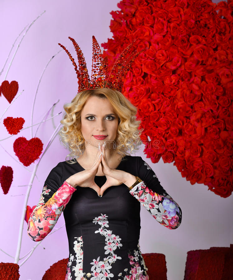 Queen of Valentine.Proud,powerful,amazing,gorgeous blonde woman with big red creative crown on her head. royalty free stock photo