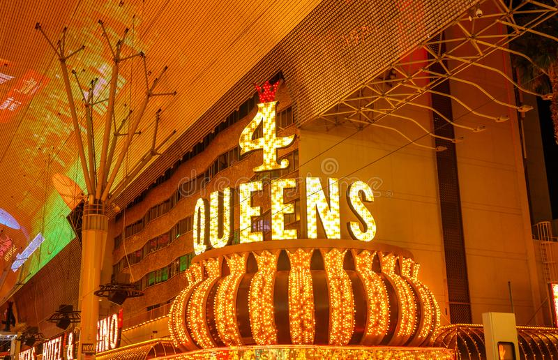 4 QUEENS CASINO, street sign at night. stock photography