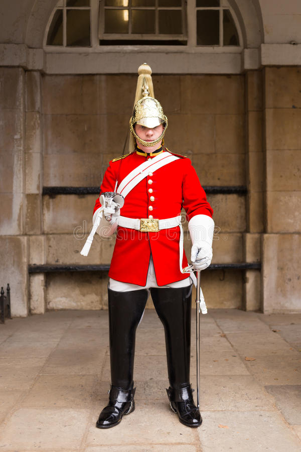 Queens Guardsman. LONDON, UK - 26TH SEPTEMBER 2014: A Queens Guardsman standing to attention near Horse Guards Parade in London royalty free stock images