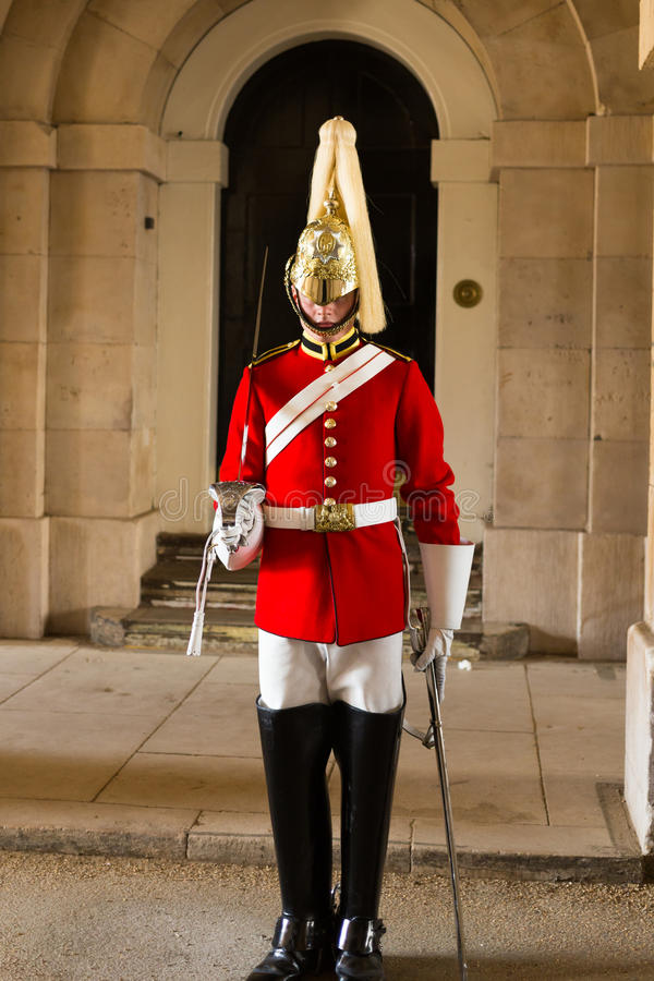 Queens Guardsman. LONDON, UK - 26TH SEPTEMBER 2014: A Queens Guardsman standing to attention near Horse Guards Parade in London stock images