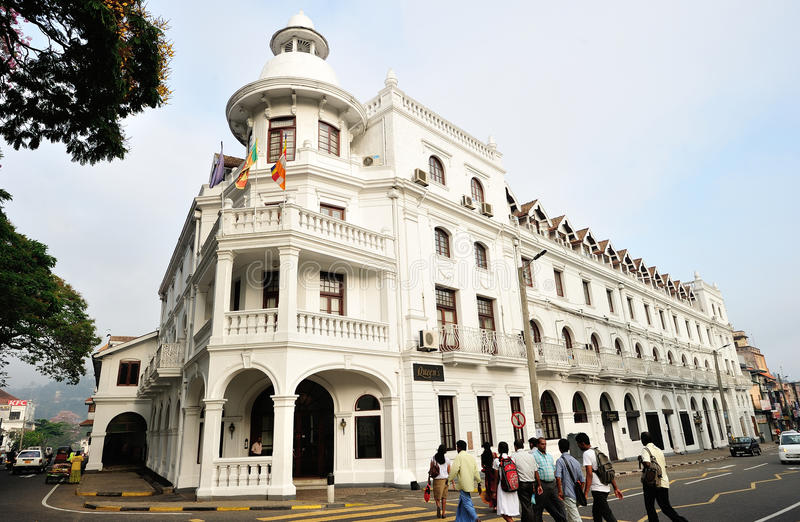 QUEENS HOTEL KANDY LAKE SRI LANKA. Queen's Hotel is a historic building located 51 m from Kandy Lake. It offers colonial-style accommodations with an outdoor stock photo