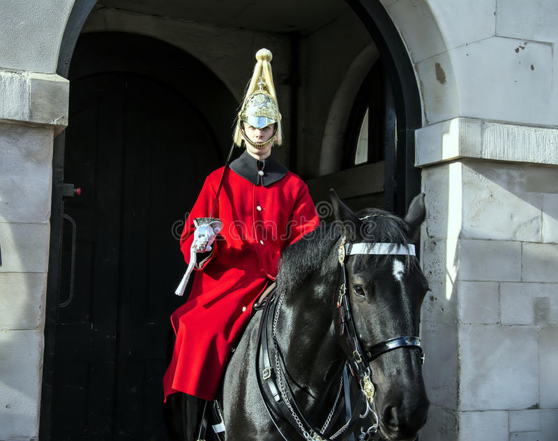 The Queens lifeguards on horseback outsid Horse Guards Parade in royalty free stock image