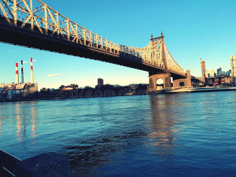 Queensboro bridge over newyork city east river at sunset . stock photos