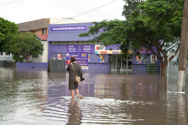 Queensland Floods: Man walking in the water royalty free stock photos
