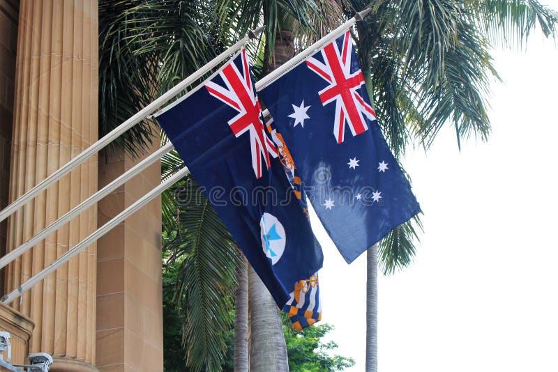 Queensland och Australien flagga arkivbilder