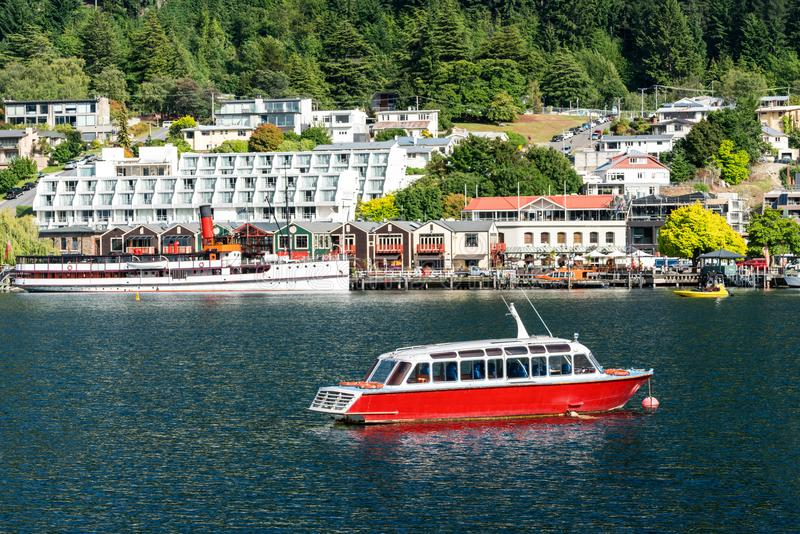 Lakefront of Queenstown City, New Zealand. Queenstown lakefront city center shot at Lake Wakapitu, the famous lake of Queenstown, center of tourism, water sport royalty free stock photography