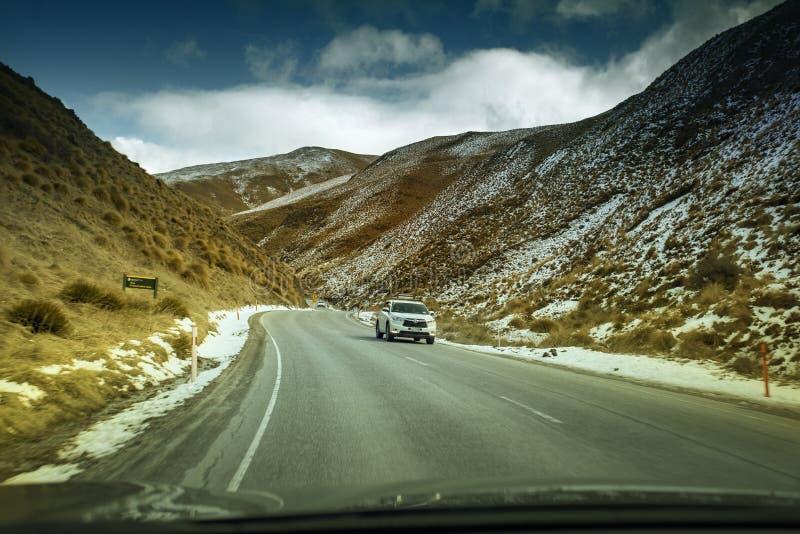 QUEENSTOWN NEW ZEALAND - SEP5,2015 : tourist car driving pass cr stock photo