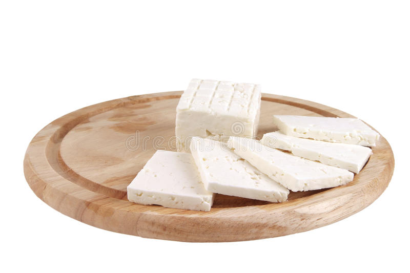 Queijo branco cortado na placa foto de stock royalty free