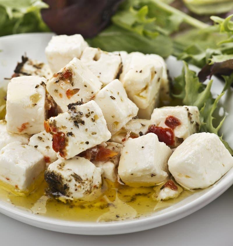 Queijo de feta com Olive Oil And Herbs imagem de stock royalty free