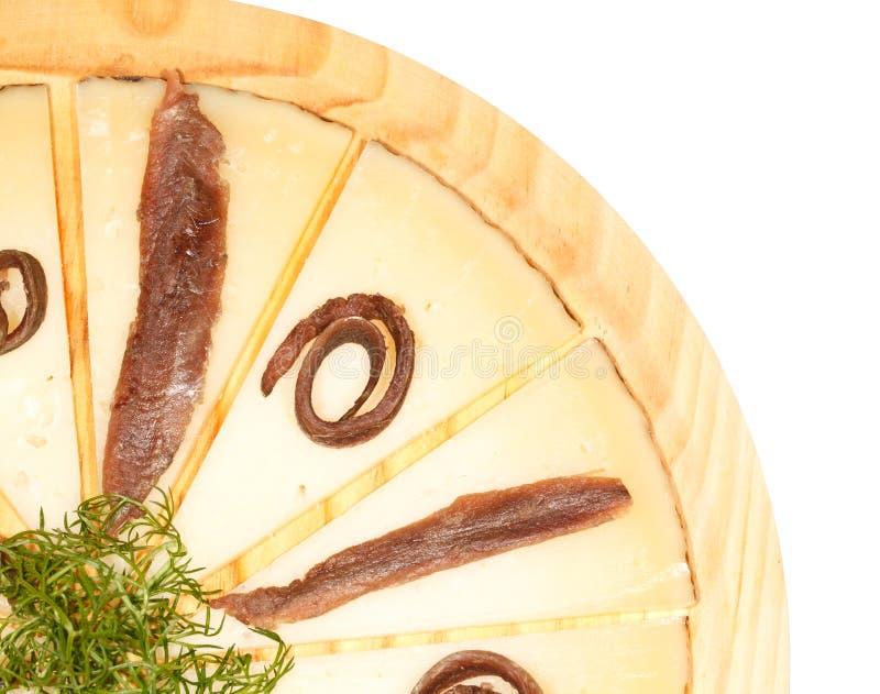 Queijo e anchovas imagens de stock