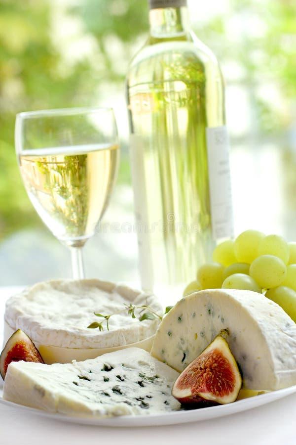 Queijo, uva, figos e vinho fotos de stock royalty free
