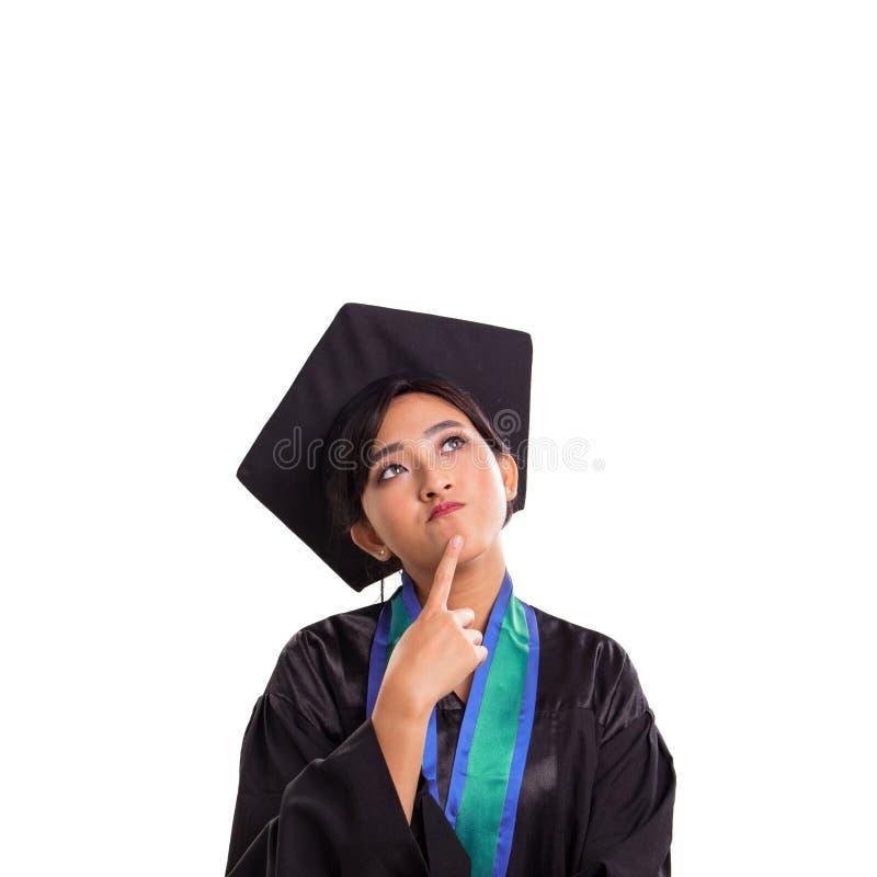 Quel ` s dans l'esprit de l'étudiante graduée fraîche image libre de droits