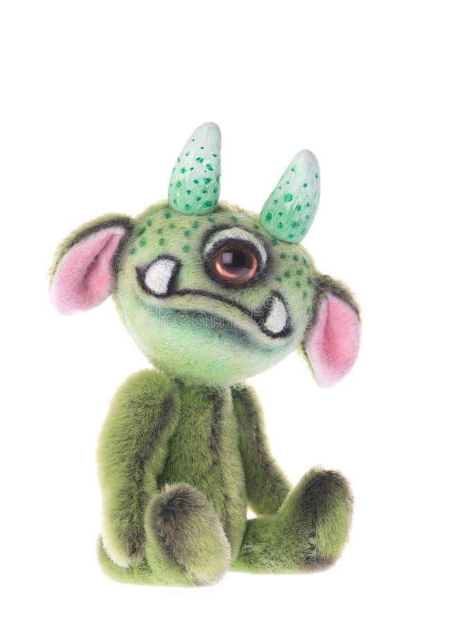 Quello farcito sveglio ha osservato il giocattolo verde animale del mostro immagini stock