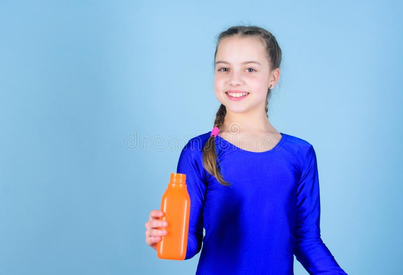 Quench thirst. Child feel thirst after sport training. Kid cute girl gymnast sports leotard hold bottle for drink. Water. Balance and hard gym training. Drink royalty free stock photo