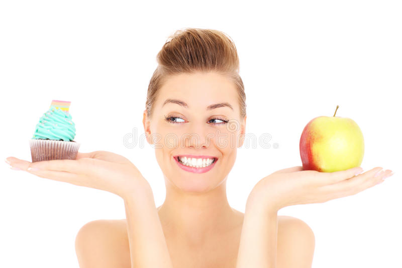 Queque e maçã da mulher fotografia de stock royalty free