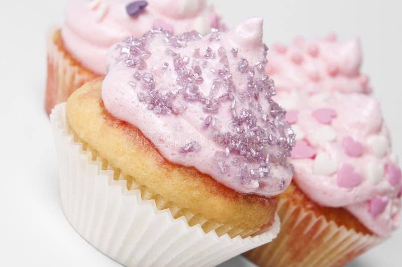 Queques cor-de-rosa caseiros fotos de stock