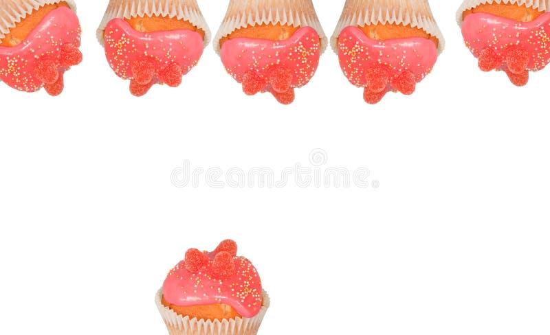 Queques cor-de-rosa geados fotografia de stock royalty free