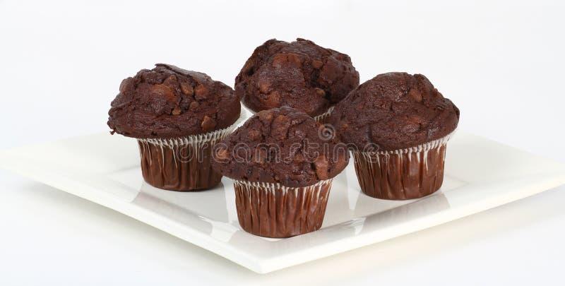 Queques da microplaqueta de chocolate fotos de stock