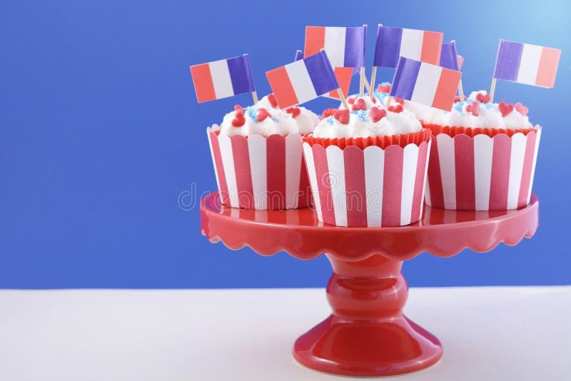 Queques felizes do dia de Bastille imagem de stock
