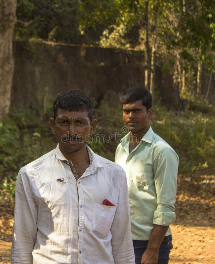 two Indian men on a blurred background of trees royalty free stock photos