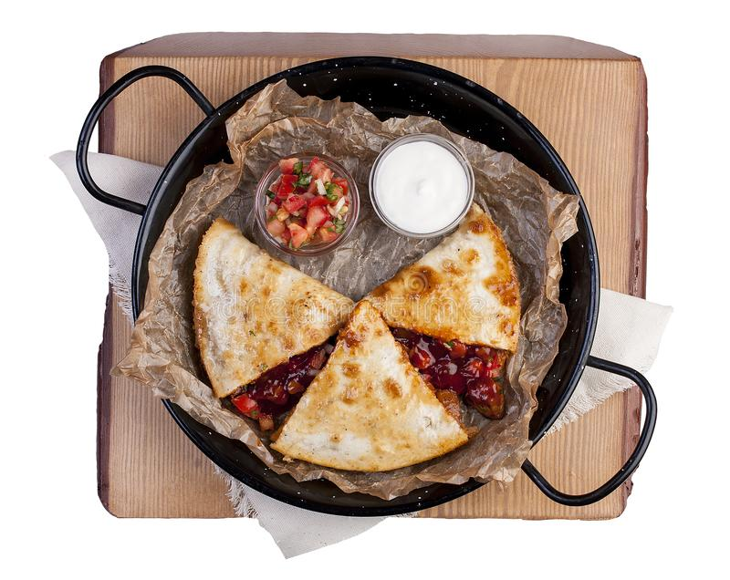 Quesadilla with cheese, salsa, pork and pineapples. Top view on white background stock photo
