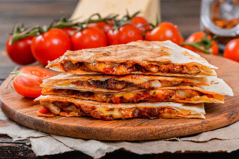Quesadilla on a wooden table stock images