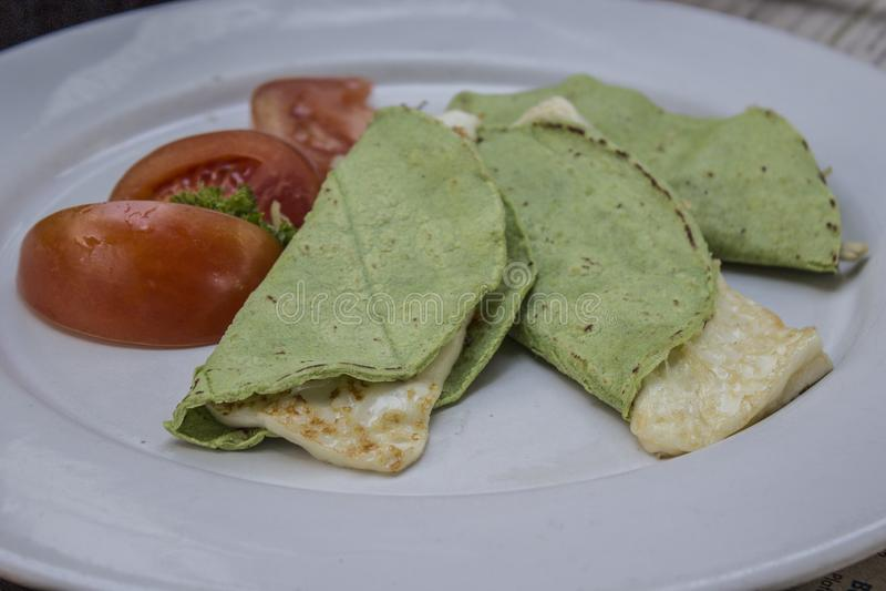 Quesadillas with green tortilla with panela cheese royalty free stock photos