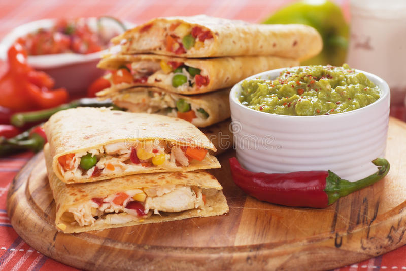 Quesadillas with guacamole dip royalty free stock image