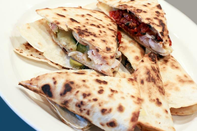 Quesadillas on a white plate stock photos