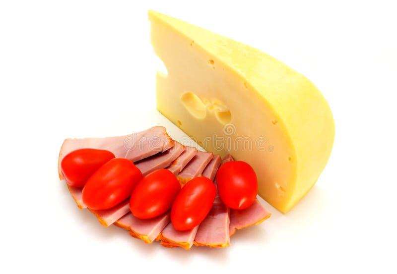 Queso Con Una Carne Y Tomates Imágenes de archivo libres de regalías