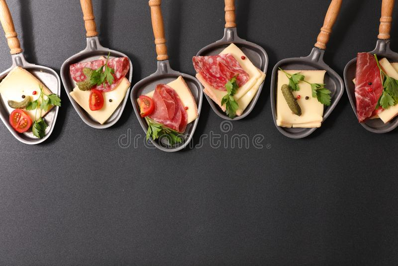 Queso de Raclette imagenes de archivo