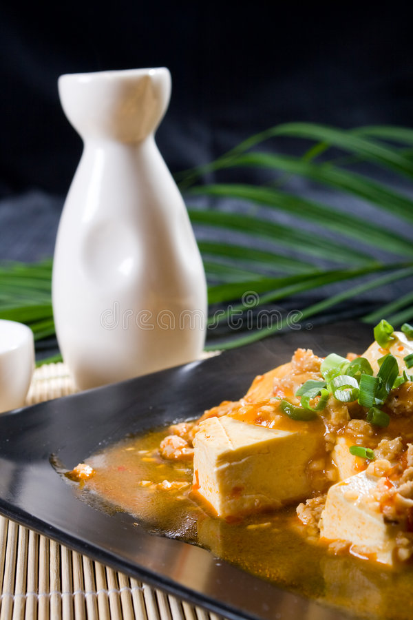 Queso de soja y saki fotografía de archivo